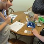 Two children doing St Patricks Day crafts