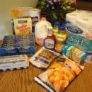 Grocery shopping trip with coupons and savings.