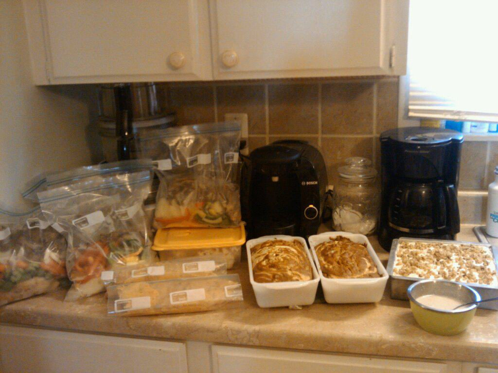 Kitchen counter full of freezer meals and healthy groceries.