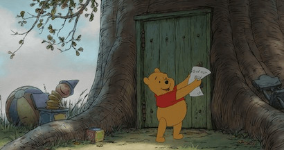Winnie the Pooh holding a paper in the air.
