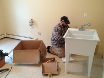 Installing a laundry tub.