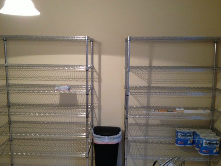 Pantry shelves lined against the wall.