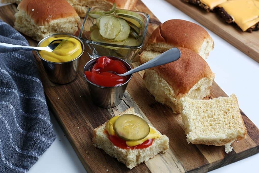 Sliced pickles and bread for sliders.