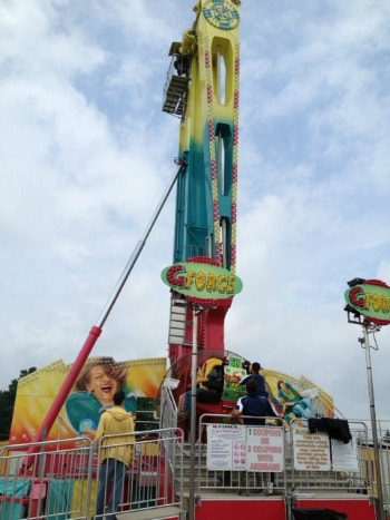 A group of people riding on a carnival ride.