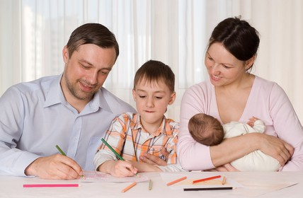 happy family of four deciding on how to become a single income family.