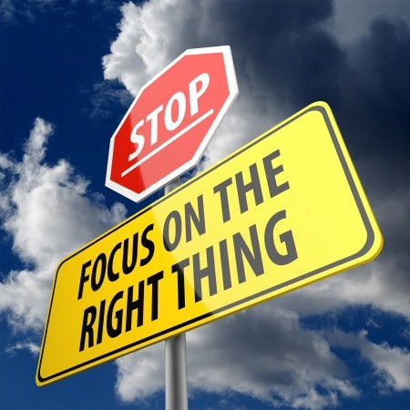 """Road sign that reads \""""Focus on the right thing.\"""""""