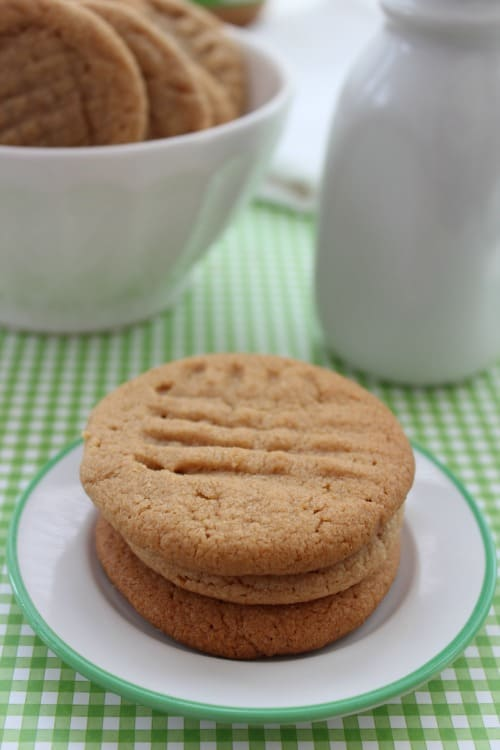A close up of a plate of food and a cup of coffee, with Peanut butter cookie