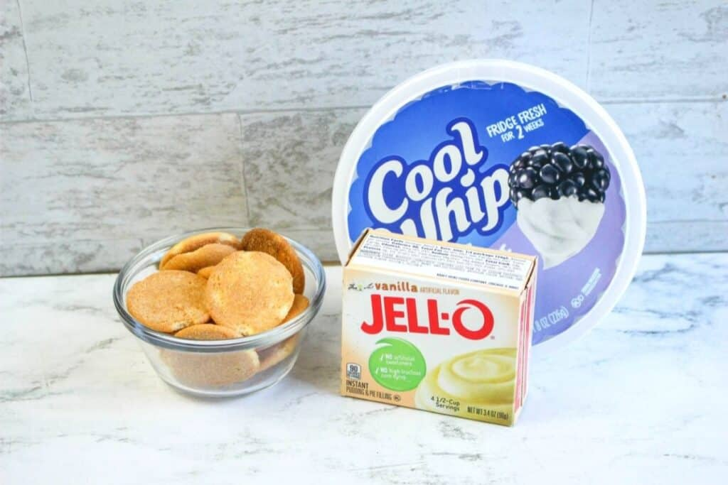 Ingredients for banana cream pie, including Nilla cookies, vanilla jello, and cool whip.