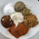 different herbs on a white plate