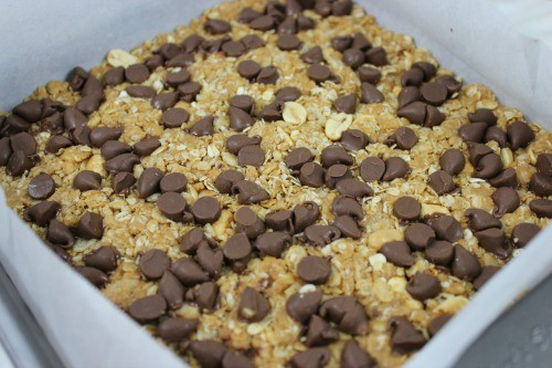 Chocolate chips on top of the peanut butter granola bars.