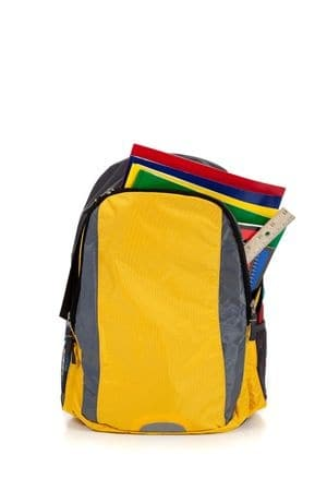 A school backpack full of school supplies.