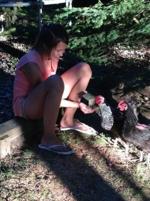 Kara with chickens