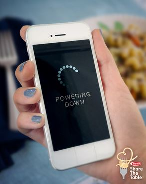 Turn off technology and disconnect from electronics during family dinner.