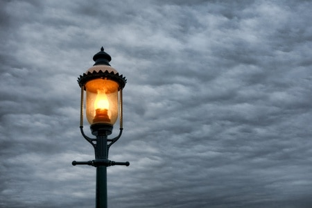A lamp post on a cloudy day