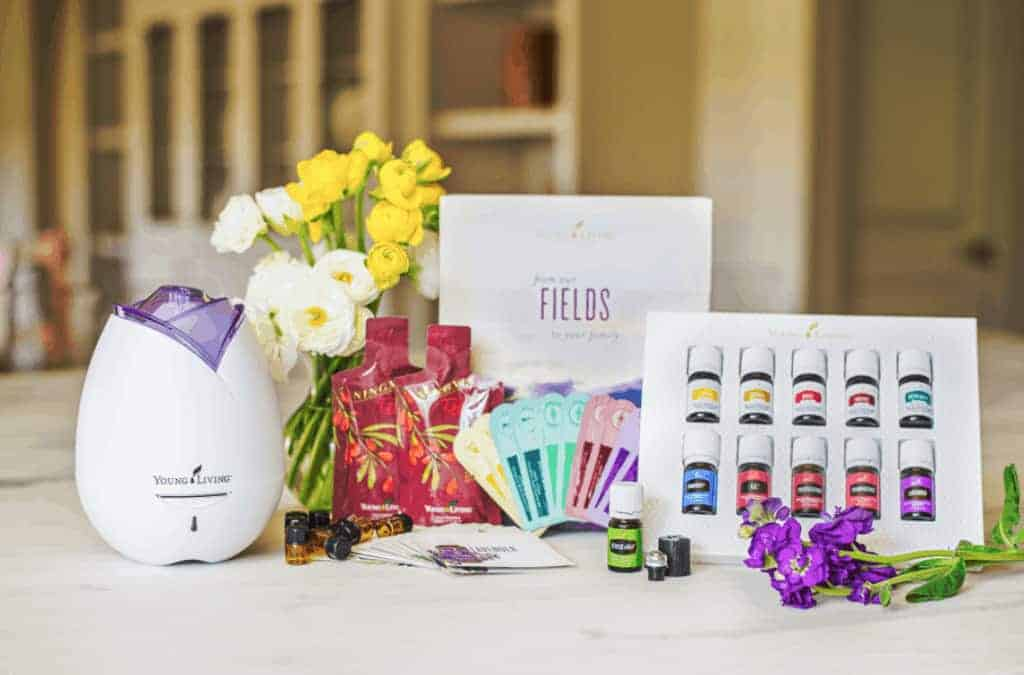 A vase of flowers on a table. Young Living Essential Oils