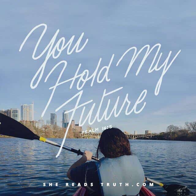 """A person sitting in a boat on a body of water with the title \""""You Hold My Future.\"""""""