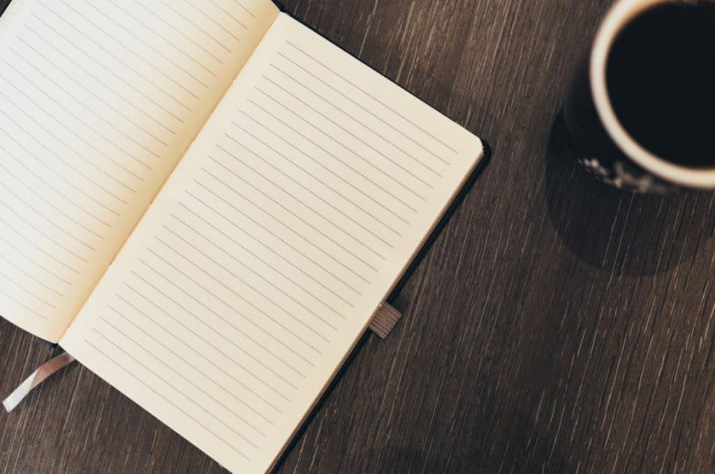 A lined notebook to write thoughts and feelings inside.