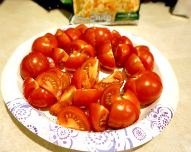 A plate of tomatoes cut up for serving.