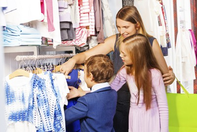Woman with two children shopping together. Raising Money-Smart Kids: Lessons from Back-to-School Shopping
