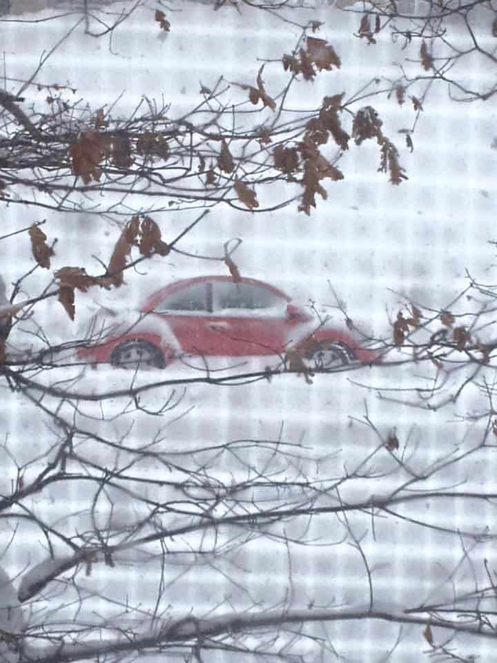 A car covered in snow and ice.