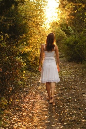 Girl walking down a pathway.