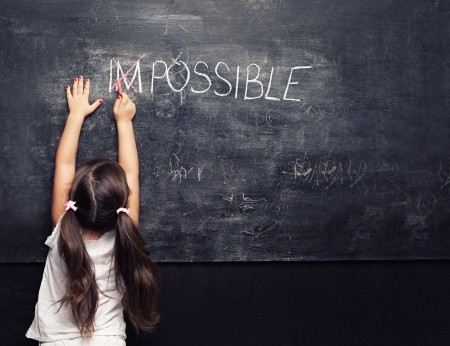 "Little girl creating the word ""Possible."""
