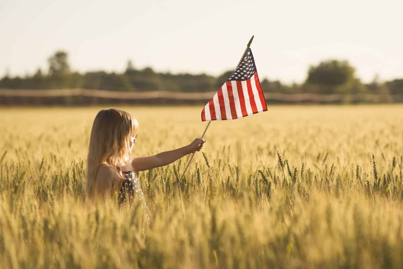 50129843 - little girl with american flag