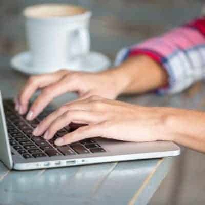 39335877 - woman hands typing on laptop