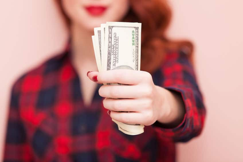 woman holding a handful of cash