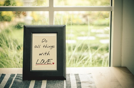 53135371 - inspirational quote : do all things with love in wooden frame