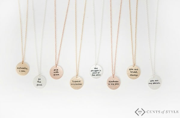 Circle necklace with motivational phrases and quotes.