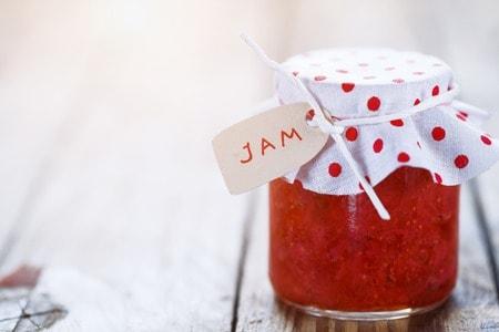 48507253 - fresh strawberry homemade jam in jar on white wood background. healthy organic and vegan food.