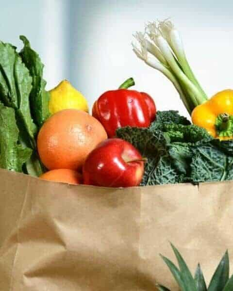 brown grocery bag filled with produce