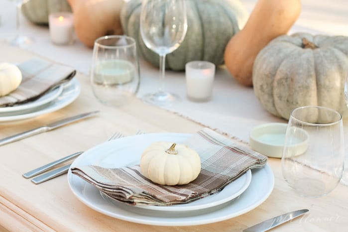 A plate of food and glasses of wine on a table, with Thanksgiving and Pumpkin