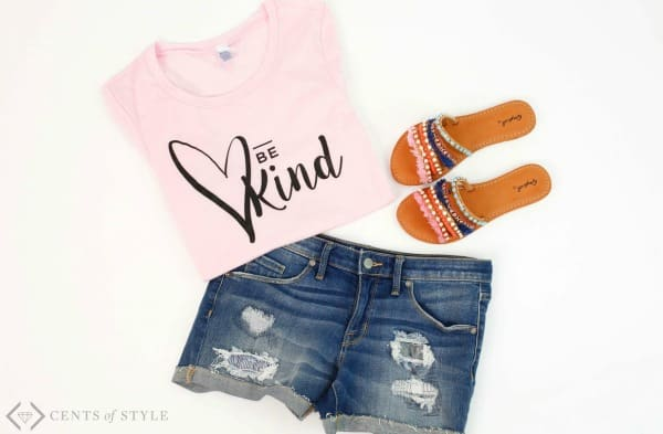 """Pink \""""Be Kind\"""" t-shirt and blue shorts."""