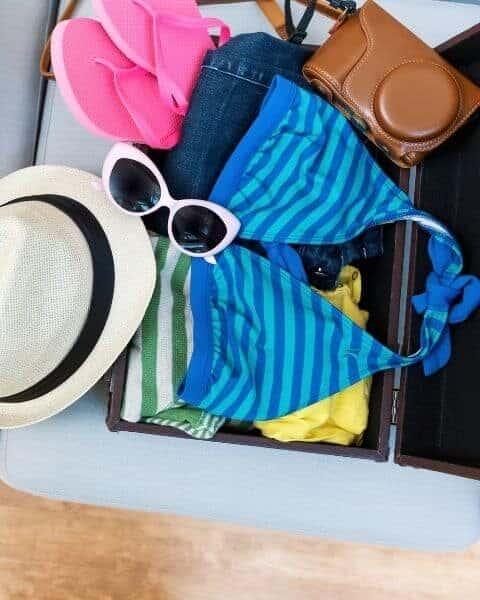 beach essentials and accessories in a bag
