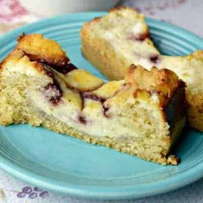 A piece of cake on a plate, Raspberry Cheesecake Loaf