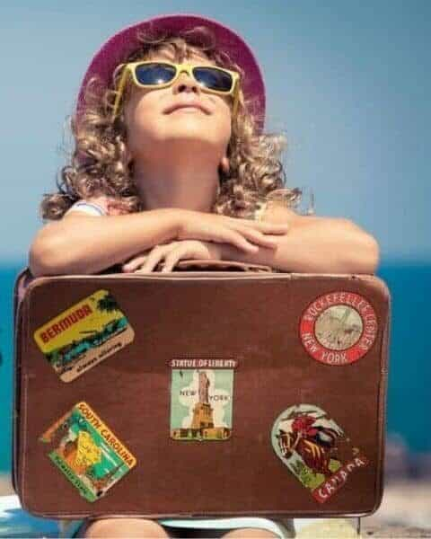 educational vacations with a girl holding her suitcase for traveling the world