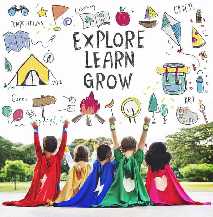 A group of children sitting on the ground together wanting to explore, learn, and grow.