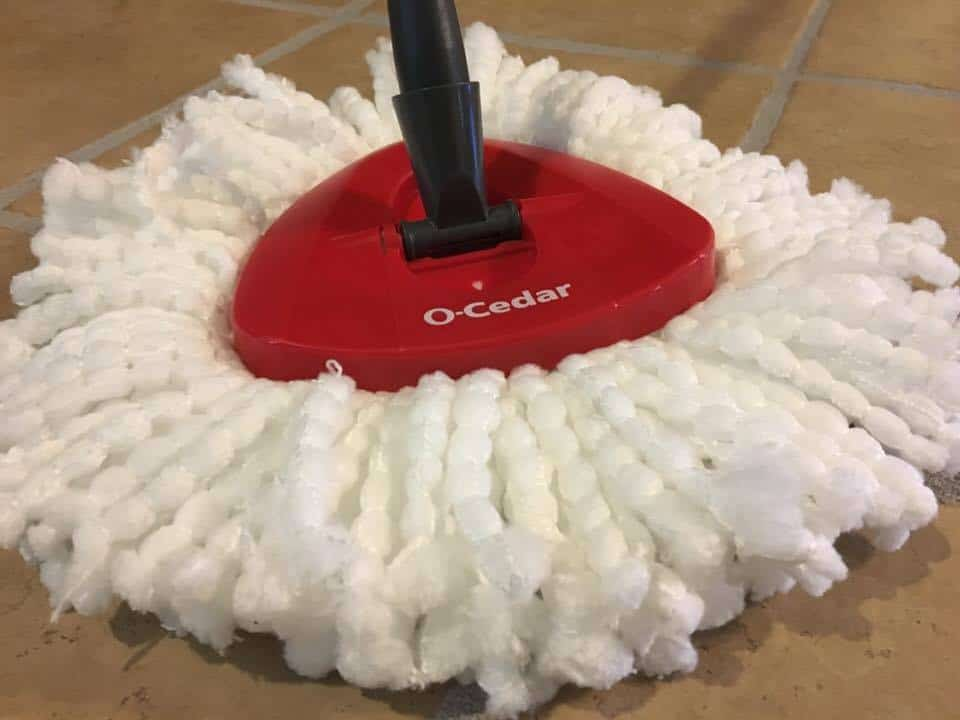 A close up of the O-cedar easy wring spin mop.