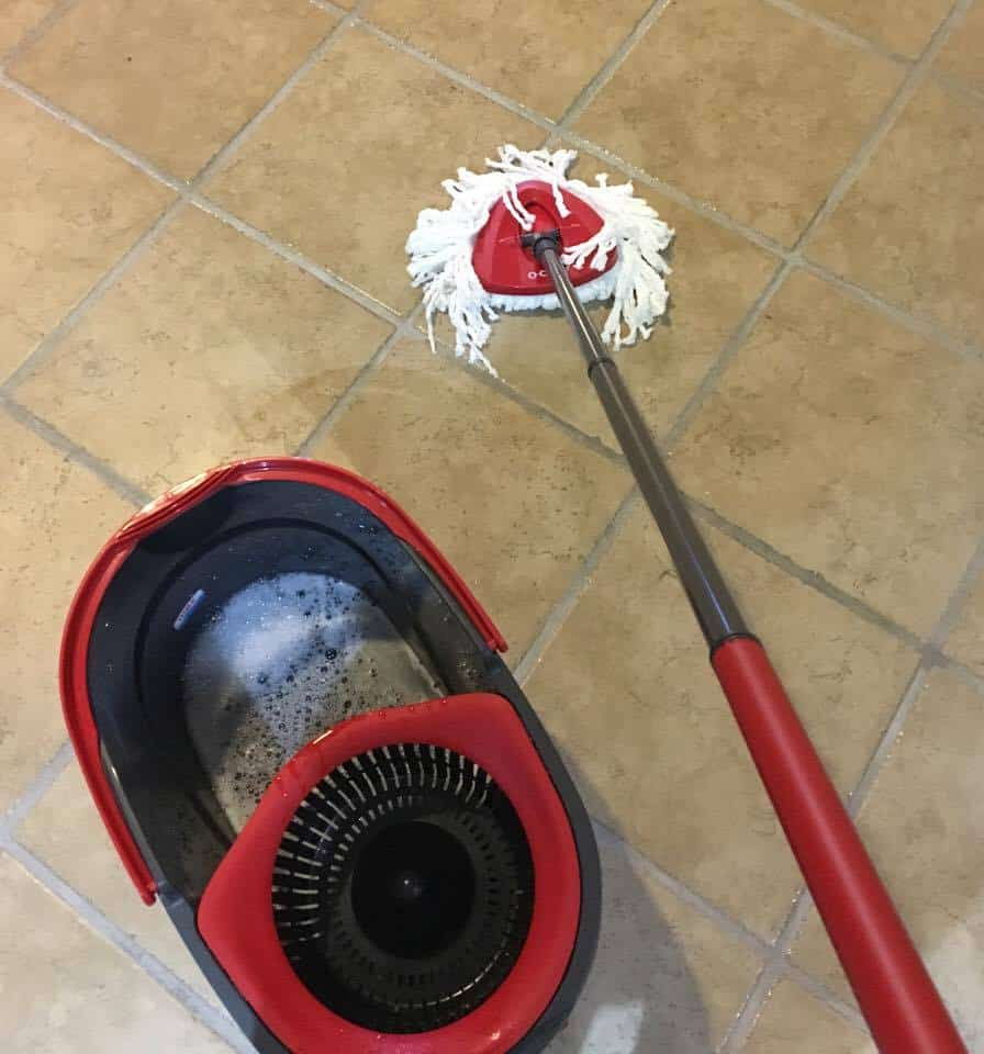O-cedar easy wring spin mop cleaning a kitchen floor.