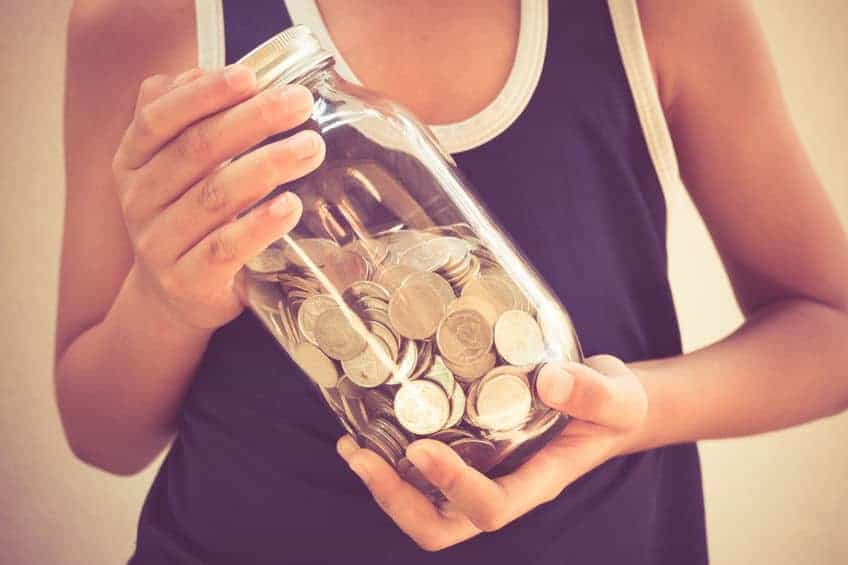 Kid with mason jar full of coins.