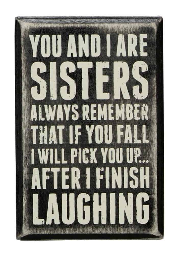 Humorous sign about sisters.