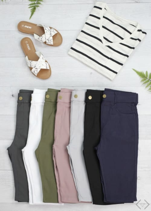 Several colored jans and a striped shirt flatlay