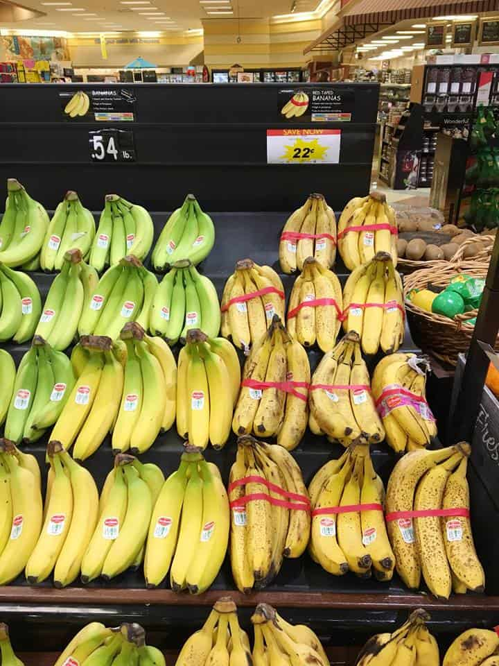 A bunch of bananas on display in a store