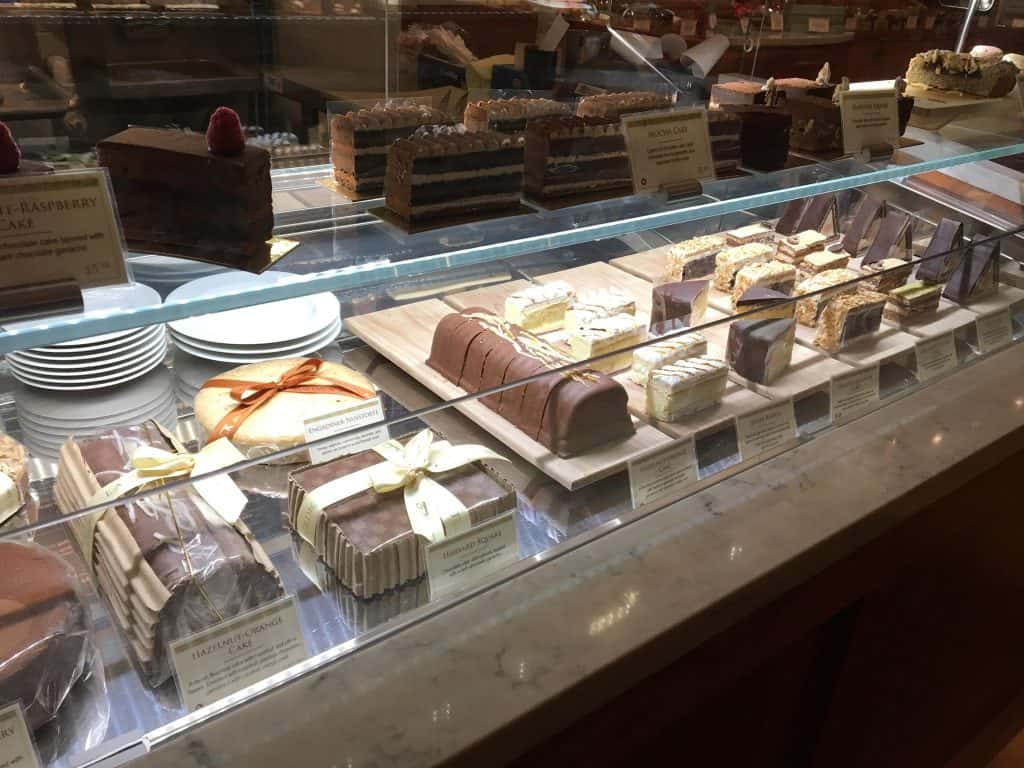 A bunch of delicious desserts, mostly chocolates, on display behind a counter in Chicago.