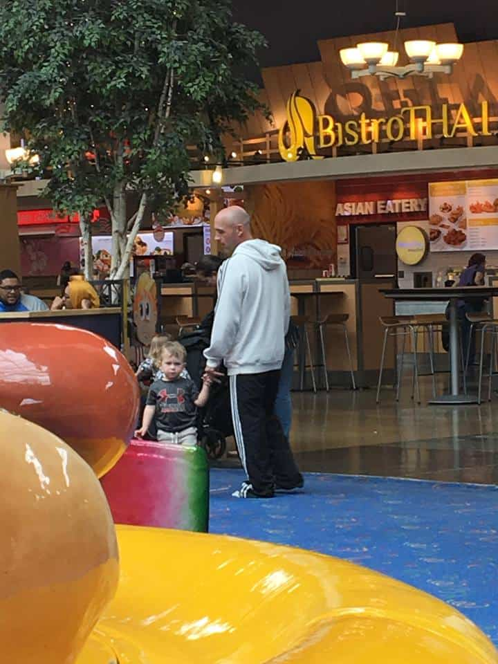 Grandpa and grandson at the local food court mall.