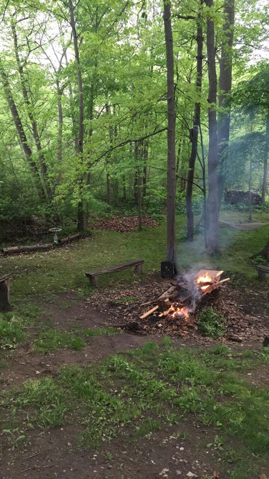 A campfire in the middle of the forest.