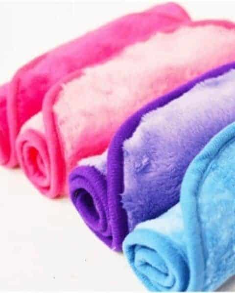 several rolled up colored washcloths