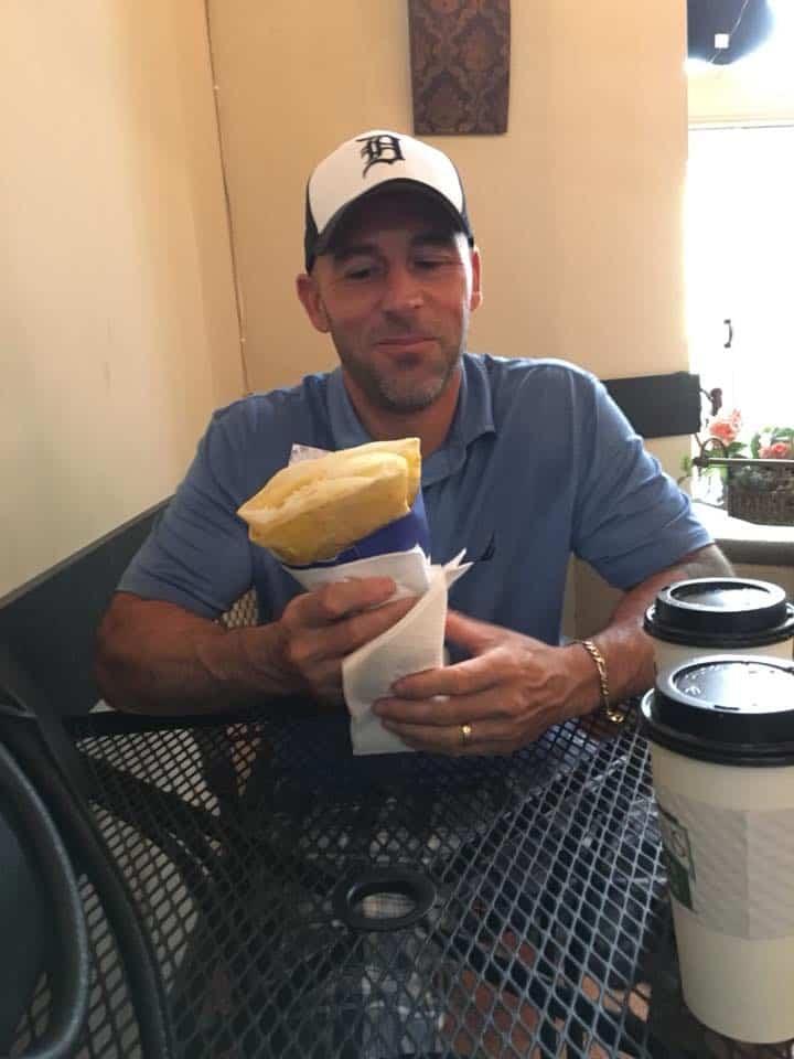 A man eating a hot dog. The Bavarian Inn Summertime Edition